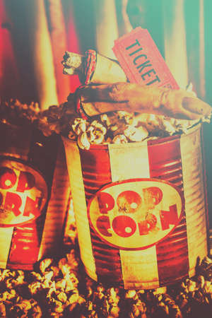 horror movies: Retro zombie movie snack with monster fingers in a cinema pop corn container with theater ticket stub. Halloween horror movies