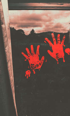 pain killers: Sinister dark rural scene on blood smeared hand prints splotched on interior window. Mark of murder