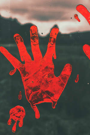 grimy: Grimy horror scene of red halloween hand print stained on countryside window. Pressing terror Stock Photo