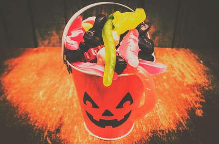 Orange halloween object photo on a sinister Jack-o-lantern head with evil smile. Retro trick or treat pumpkin head