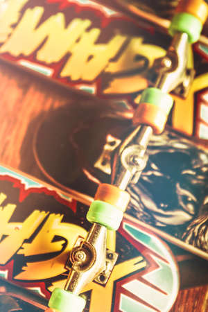 Closeup on a bunch of toy skateboards with wheels trucks and decks upside down. Skateboarding cool