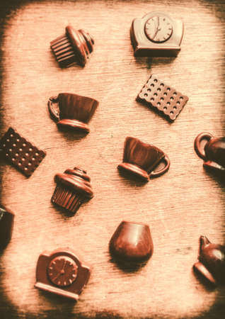 iconography: Coffee shop iconography with chocolate coffee cups and tea kettles on wooden cafe background