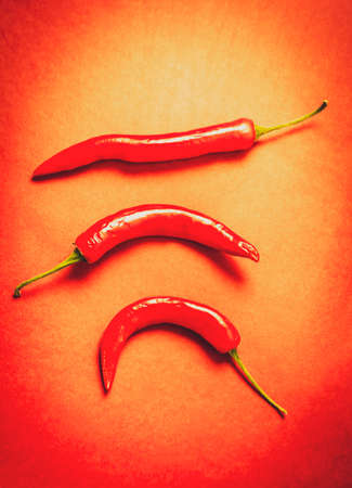 scorching: Food ingridents still life on three chili peppers with hot chillie copyspace. Scorching foods Stock Photo