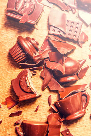 disturbance: Domestic disturbance concept in a broken chocolate disaster of smashed tableware in shapes and forms of kitchen symbols Stock Photo