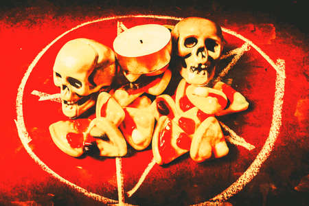 Scary object photography on a spell to Satan with pizzas and skulls under offering. Pizzagate Stock Photo