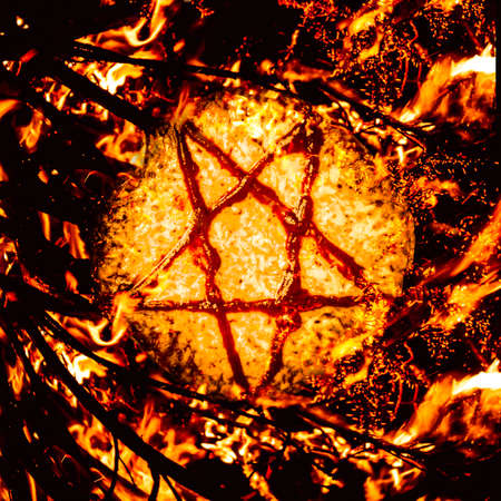 hellish: Saucery in a satanic star burning in a occult ritual of pizza sacrifice. Pizzagate inferno