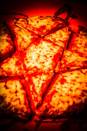 Cursed cheese pizza sliced and diced in a rite o black magic. Demonic star pizza