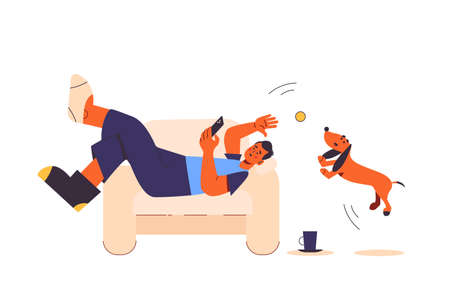 Lazy depressive man wearing different mismatched colored socks. Lonelines and apathy. Lying upside down on the couch. Playing with smartphone and cat. Boring exhausting day in mess. Isolated.