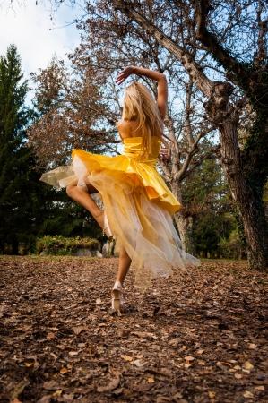 women s fashion: Ballerina In The Park Stock Photo