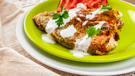 Vegetarian Stuffed Fried Peppers, Topped With Garlic Sauce photo