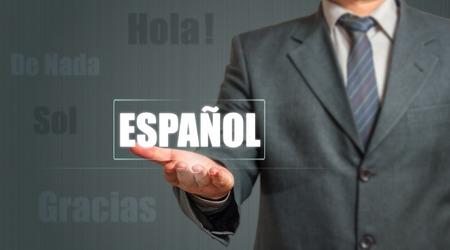 spanish language: Business man Showing Spanish Language Label