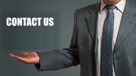 contact us sign: Business Man Showing Contact Us Sign. Copy Space Stock Photo