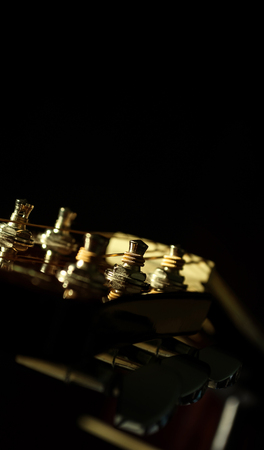 backgraound: Closeup Of Acoustic Guitar Over Black Backgraound Shallow Depth Of Field