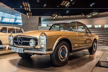 made in germany: Photo made on June 25, 2017 - Mercedes-Benz Museum, Stuttgart, Germany - The Mercedes-Benz 230 SL was the worlds first sports car with a sturdy passenger cell and crumple zones. Editorial