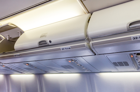 Overhead compartment - detail of an airplane cabin interior