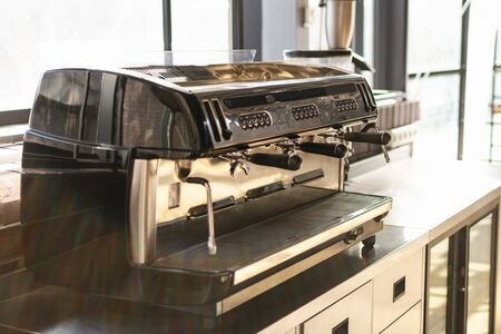 close up view of professional coffee machine on kitchen. sunny day, vintage color tones