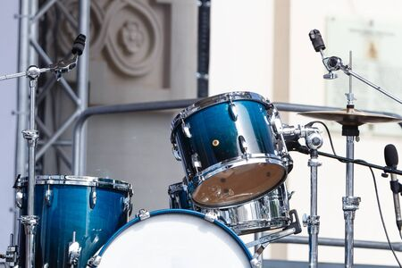 Modern drum set on open scene prepared for playing. Sunny day Stok Fotoğraf - 131848987
