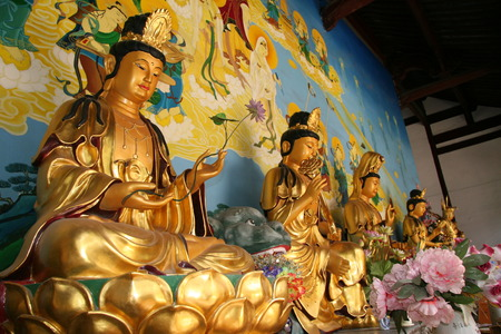 sacrifices: Golden buddha statues in Chinese temple in Suzhou