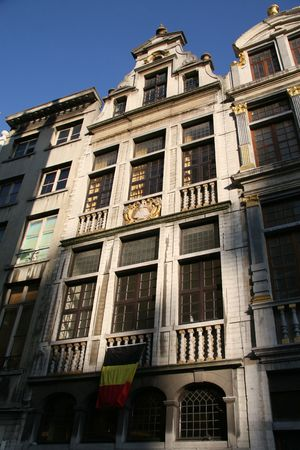 Grand Place in Brussels - old houses with Belgian flag Stock Photo - 2268618