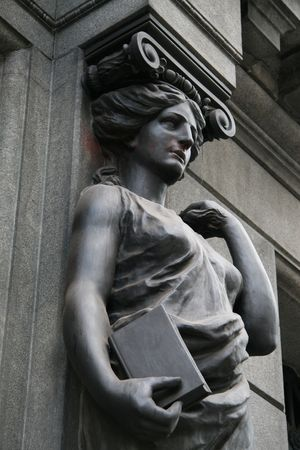 allegorical: Statue holding book at library of congress in Buenos Aires