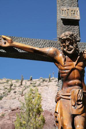 Wooden statue of Jesus on the cross near Salta, Northwest Argentina. Stock Photo - 2533352