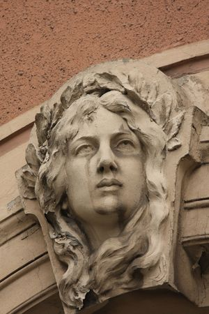 Detail of womans head on Art Nouveau house in Riga