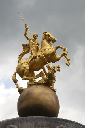 Golden statue of Saint George slaying the dragon in the town of Telavi in eastern Kakhet province of the Caucasian republic of Georgia. Stock Photo