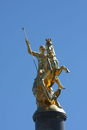 slaying: Golden statue of Saint George slaying the dragon, in the capital Tbilisi of the Caucasian republic of Georgia.