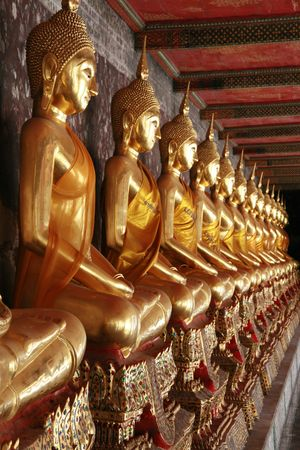Row of golden Buddha statues in Wat Pho, Bangkok photo
