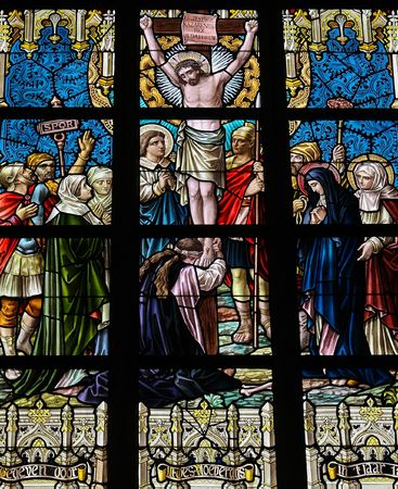 crucifiction: Jesus on the cross (1895). Stained glass church window in Alsemberg, Flanders.
