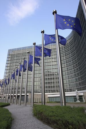 European flags waving in the wind, before the European Commission Berlaymont building in Brussels, Belgium Standard-Bild