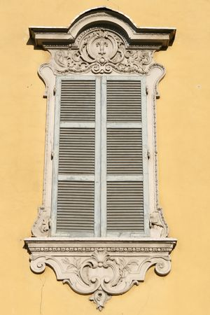 A window at a classical house in the typical regional color, yellow of Parma Stock Photo - 5292385
