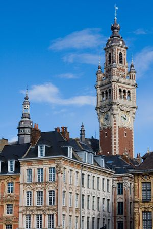 Tower of the Chambre de commerce and historic houses in Lille, France Stock Photo