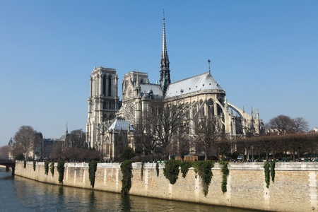 Notre Dame cathedral in the center of Paris, France, on a sunny day photo