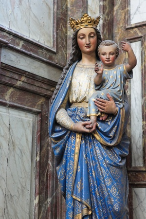 Mother Mary with Child Jesus; statue in the Saint Peters church in Leuven, Belgium. This statue was created in the 17th Century, no property release is required. photo