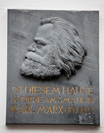 memorial plaque: Trier, Germany - November 12, 2011: Relief portrait on a plaque of Karl Marx, German philosopher, at his birthplace in the Brückenstraße 10, Trier (Karl-Marx-Haus). This plaque was created in 1947. Artist is unknown.