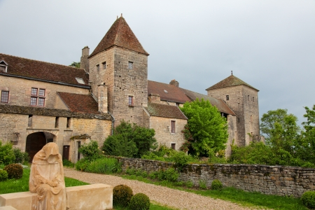 crus: The Ch&acirc,teau de Gevrey-Chambertin is a castle located in Burgundy, 12 km from Dijon and 30 km from Beaune  The statue shows Saint Bernard, and was created more than 100 years ago.