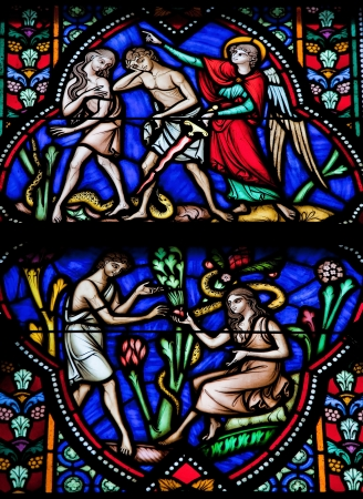 Adam and Eve eat the Forbidden Fruit and are expelled from Paradise  This window was created more than 150 years ago, no property release is required