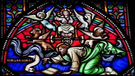 monotheism: Cherubim and Chariot vision of the Prophet Ezekiel  This window was created more than 150 years ago, no property release is required  Stock Photo