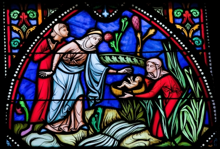 Moses is rescued from the Nile by pharaohs daughter  This window was created more than 150 years ago, no property release is required  Stock Photo