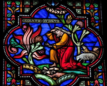 Moses and the burning bush on Mount Horeb  This window was created more than 150 years ago, no property release is required  Stock Photo