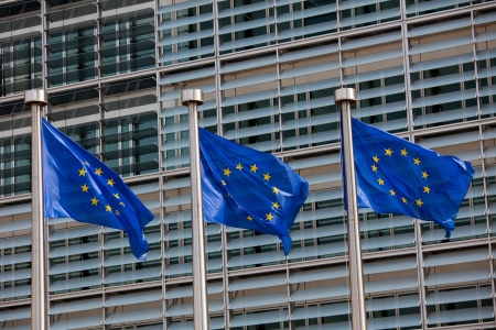 legislation: European flags in front of the Berlaymont building, headquarters of the European commission in Brussels. Stock Photo