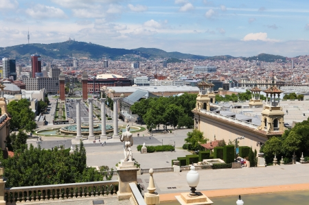 espanya: Barcelona, Spain - June 6, 2011  A view from the Mirador del Palau Nacional on the Placa d Espanya in Barcelona, with people and cars passing by