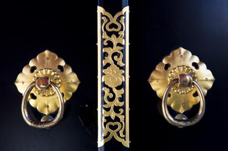 Ancient door knobs in Asakusa temple in Tokyo, Japan photo