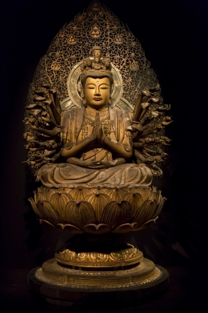 gautama: TOKYO - NOVEMBER 13: Ancient Buddha statue in a temple in Tokyo, on November 13, 2012.