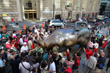 Crowd of tourists around the Wall Street Bull in New York on September 15, 2012.