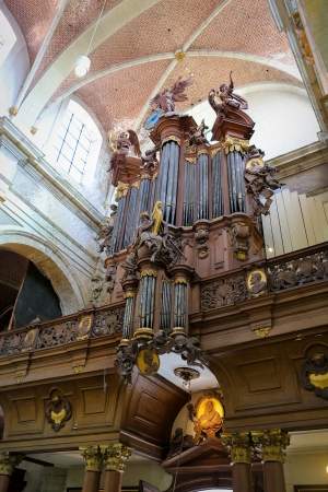 lier: Old organ in the church of the Beguinage in Lier, Belgium. This organ, including all the ornaments were created more than 250 years ago. No property release is required.