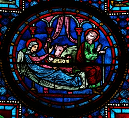 family church: Stained glass window depicting the Holy Family in Bethlehem, in the cathedral of Bayeux, Normandy, France. This window was created in the 15th century, no property release is required.