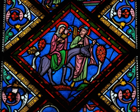 church window: Stained glass window depicting the Holy Family in Bethlehem, in the cathedral of Bayeux, Normandy, France. This window was created in the 15th century, no property release is required.