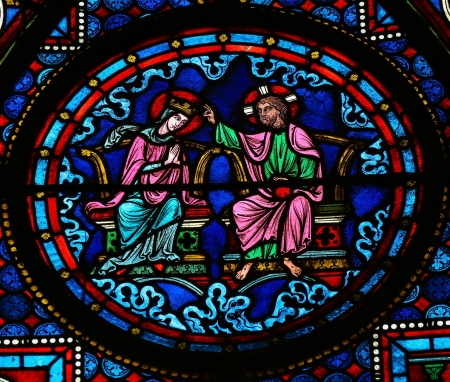 mother mary: Stained glass window depicting Jesus and Mother Mary in Heaven, in the cathedral of Bayeux, Normandy, France. This window was created in the 15th century, no property release is required.